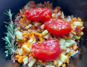 Authentic ribollita soup - rosemary, thyme, potatoes and peeled tomatoes