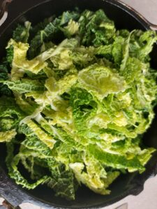 Braised pork ribs with savoy cabbage - adding the cabbage